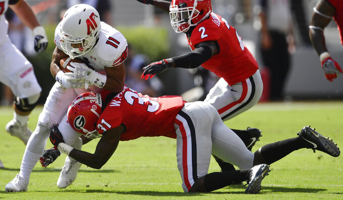 Austin Peay wide receiver DeAngelo Wilson (11) runs into Georgia defensive back William Poole (31) during the first half of an NCAA college football game, Saturday, Sept. 1, 2018, in Athens, Ga. (AP Photo/Mike Stewart)