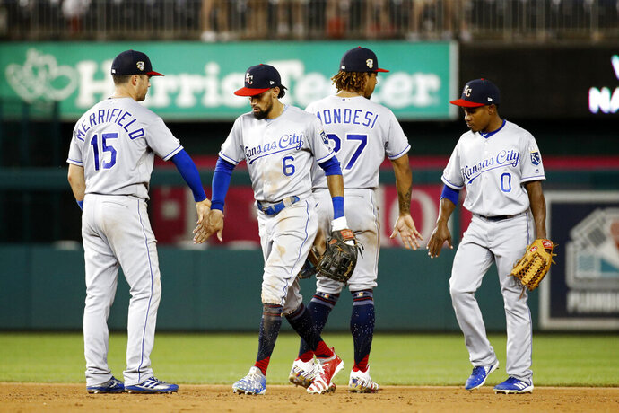 Kansas City Royals' Whit Merrifield, Billy Hamilton, Adalberto Mondesi and Terrance Gore, from left, celebrate after the team's 7-4 win in 11 innings in a baseball game against the Washington Nationals, Friday, July 5, 2019, in Washington. (AP Photo/Patrick Semansky)