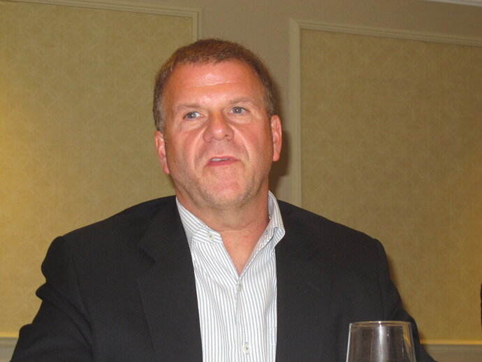 This Aug. 31, 2012 photo shows Texas billionaire Tilman Fertitta at a press conference in his Golden Nugget casino in Atlantic City, N.J. He tells The Associated Press his dual role as owner of the NBA's Houston Rockets as well as of casinos that take sports bets has actually hurt his sports betting business. (AP Photo/Wayne Parry)