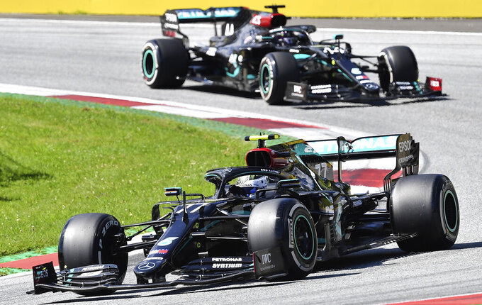 Mercedes driver Valtteri Bottas of Finland steers his car followed by Mercedes driver Lewis Hamilton of Britain during the Austrian Formula One Grand Prix at the Red Bull Ring racetrack in Spielberg, Austria, Sunday, July 5, 2020. (Joe Klamar/Pool via AP)