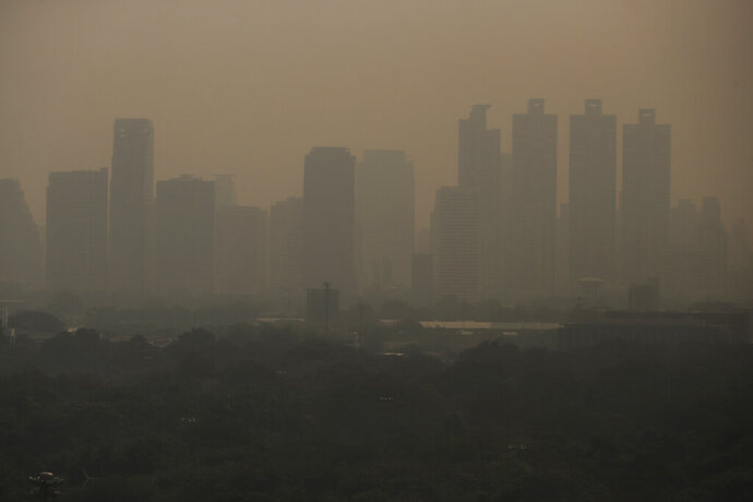 A thick layer of smog covers Lumpini Park in central Bangkok, Thailand, Monday, Sept. 30, 2019. Many provinces of Thailand, including Bangkok, are shrouded with toxic smog Monday, causing concerns among people of much worst situation in the upcoming dry season when agriculture burning season really begins. (AP Photo/Sakchai Lalit)