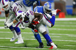Buffalo Bills running back Devin Singletary (26) is tackled by Detroit Lions defensive tackle Jashon Cornell during the first half of a preseason NFL football game, Friday, Aug. 13, 2021, in Detroit. (AP Photo/Duane Burleson)