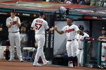 American League pitcher Shane Bieber (57), of the Cleveland Indians, is congratulated by teammate Francisco Lindor, of the Cleveland Indians, after Bieber struck out the side during the fifth inning of the MLB baseball All-Star Game against the National League, Tuesday, July 9, 2019, in Cleveland. (AP Photo/Ron Schwane)