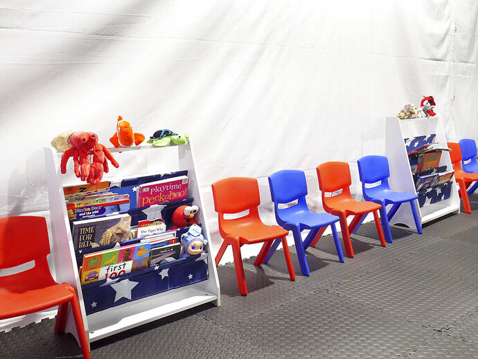 Stuff animals, story books and small chairs fill the Juvenile waiting area at the Migrant Protection Protocols Immigration Hearing Facilities in Laredo, Tuesday, September 10, 2019. The facility is schedule to open for hearings for immigrants seeking asylum on Monday, September 16, 2019. (Ricardo Santos/The Laredo Morning Times via AP)