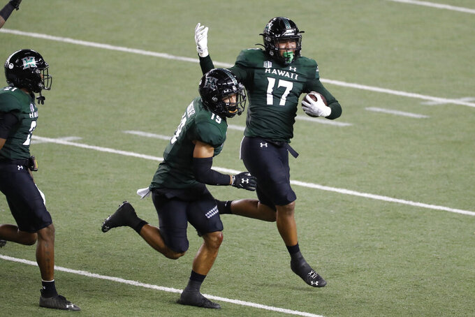 Hawaii linebacker Isaiah Tufaga (17) celebrates his fumble recovery against UNLV during the first half of an NCAA college football game Saturday, Dec. 12, 2020, in Honolulu. (AP Photo/Marco Garcia)