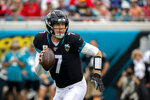 "FILE - In this Dec. 1, 2019, file photo, Jacksonville Jaguars quarterback Nick Foles (7) scrambles out of the pocket during the first half of an NFL football game against the Tampa Bay Buccaneers, in Jacksonville, Fla.  Trubisky understands why the Bears acquired quarterback Nick Foles. That doesn't mean he's ready to hand over the starting job. Trubisky said the trade for Foles gave him extra motivation to show he can develop into the franchise quarterback the Bears thought he would become when they moved up a spot to draft him with the No. 2 overall pick in 2017. ""That's the business we're in,"" he said in a conference call on Friday, June 12, 2020. (AP Photo/Stephen B. Morton, File)"
