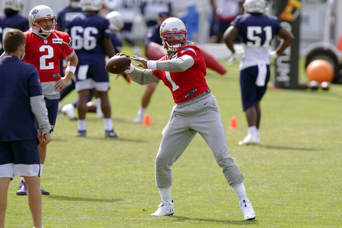 New England Patriots quarterback Cam Newton passes the ball as quarterback Brian Hoyer (2) watches during an NFL football training camp practice, Wednesday, Aug. 26, 2020, in Foxborough, Mass. (AP Photo/Steven Senne, Pool)