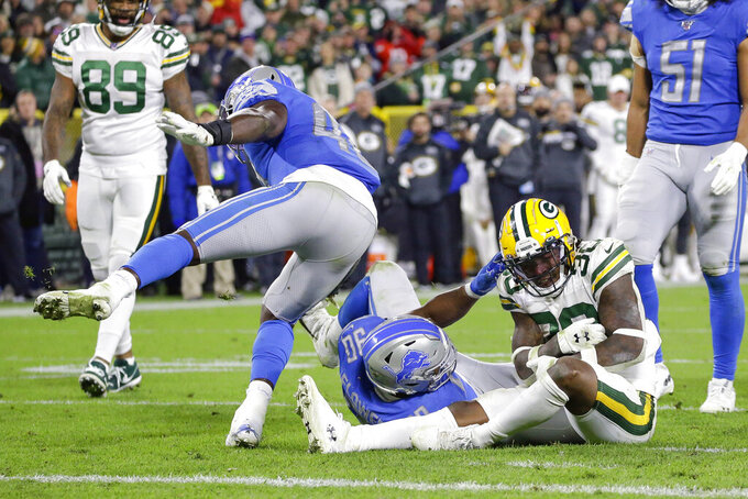 Green Bay Packers running back Jamaal Williams  (30) stops short of the goal line to keep the clock running in the last minute of the second half of an NFL football game against the Detroit Lions, Monday, Oct. 14, 2019, in Green Bay, Wis. (AP Photo/Jeffrey Phelps)