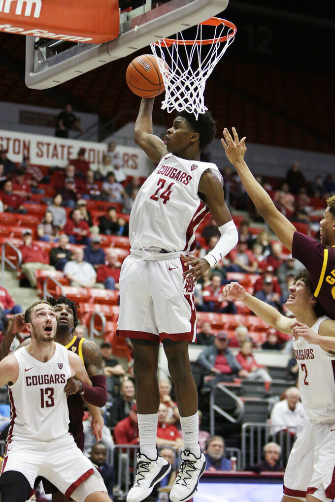 Washington State guard Noah Williams (24) grabs a rebound during the second half of an NCAA college basketball game against Arizona State in Pullman, Wash., Wednesday, Jan. 29, 2020. Washington State won 67-65. (AP Photo/Young Kwak)