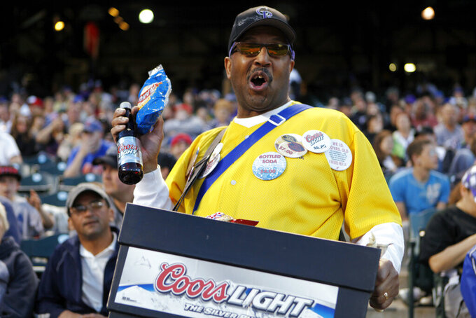 FILE - In this May 9, 2011, file photo, a vendor sells beer and peanuts at a Colorado Rockies baseball game at Coors Field in Denver. As sports have begun to return around the world, the only thing that even comes close to normalcy is happening on the field. For the fans, team owners, sponsors and just about everyone else associated with college and professional sports, the coronavirus pandemic has forced changes both big and small. (AP Photo/Ed Andrieski, File)