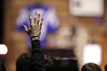 A Purdue football player raises his hand while singing a song during a funeral for Tyler Trent at College Park Church, Tuesday, Jan. 8, 2019, in Indianapolis. Trent, an avid Purdue fan, died on New Year's Day, following a bout with bone cancer. (AP Photo/Darron Cummings, Pool)