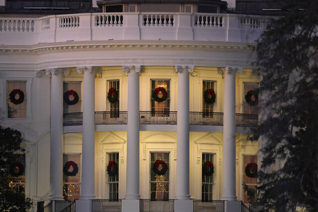In this Dec. 5, 2019 photo, a view of the south side of the White House in Washington decorated for Christmas. The Associated Press-NORC Center for Public Affairs Research poll released Friday finds only about 1 in 10 Americans expect a downturn in their own lives in 2020. But about 4 in 10 say the way things are going nationwide will get worse in the year ahead. 2020 is an election year, and that might have something to do with it: Most Democrats and Republicans alike say they're dissatisfied with the state of politics. (AP Photo/Susan Walsh)