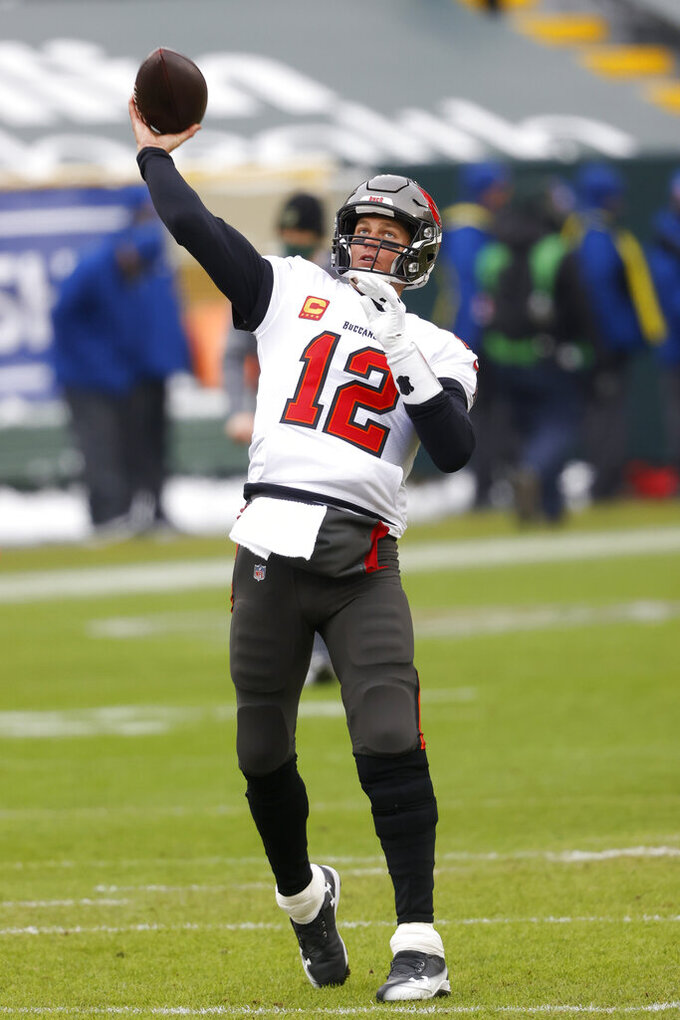 Tampa Bay Buccaneers quarterback Tom Brady warms up before the NFC championship NFL football game against the Green Bay Packers in Green Bay, Wis., Sunday, Jan. 24, 2021. (AP Photo/Jeffrey Phelps)