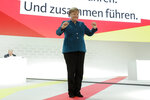 Christian Democratic Union, CDU, chairwoman and German Chancellor Angela Merkel receives the applause after her speech during a party convention of the Christian Democratic Party CDU in Hamburg, Germany, Friday, Dec. 7, 2018. 1001 delegates are electing a successor of German Chancellor Angela Merkel who doesn't run for party chairmanship after more than 18 years at the helm of the party. (AP Photo/Markus Schreiber)