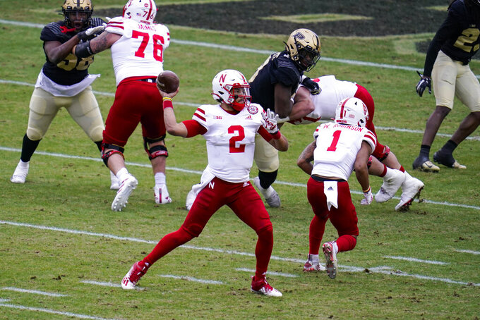 Nebraska quarterback Adrian Martinez (2) throws against Purdue during the first quarter of an NCAA college football game in West Lafayette, Ind., Saturday, Dec. 5, 2020. (AP Photo/Michael Conroy)