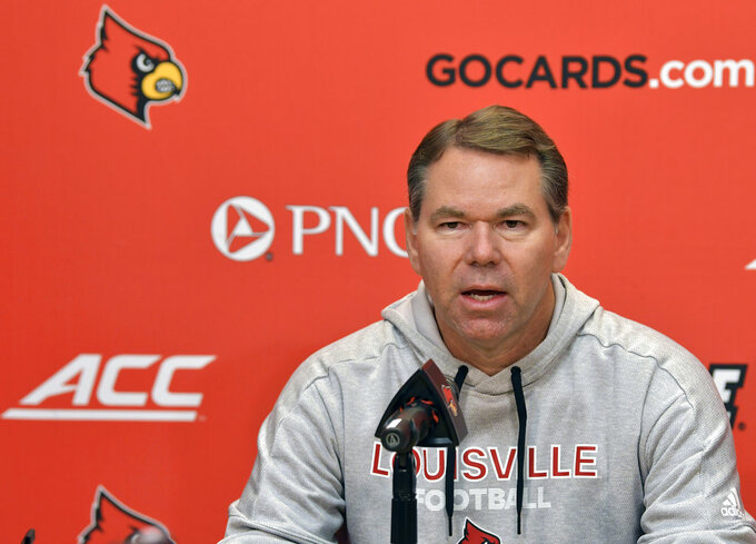University of Louisville athletic director Vince Tyra speaks to the media during a news conference in Louisville, Ky., Sunday, Nov. 11, 2018. Tyra announced the termination of head football coach Bobby Petrino, along with three of his assistants. (AP Photo/Timothy D. Easley)