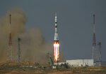In this image provided by NASA, the Soyuz MS-18 rocket is launched with NASA astronaut Mark Vande Hei, Roscosmos cosmonauts Pyotr Dubrov and Oleg Novitskiy, Friday, April 9, 2021, at the Baikonur Cosmodrome in Kazakhstan.  The Russian-U.S. trio of space travelers launched successfully Friday, heading for the International Space Station.(Bill Ingalls/NASA via AP)