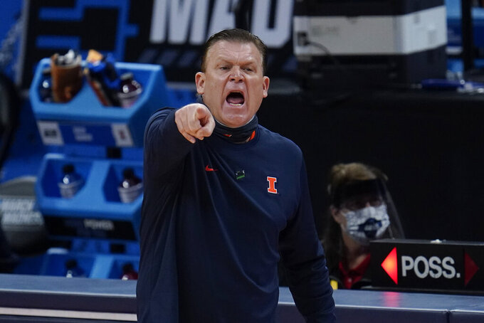 Illinois head coach Brad Underwood points against Loyola Chicago during the first half of a men's college basketball game in the second round of the NCAA tournament at Bankers Life Fieldhouse in Indianapolis, Sunday, March 21, 2021. (AP Photo/Paul Sancya)