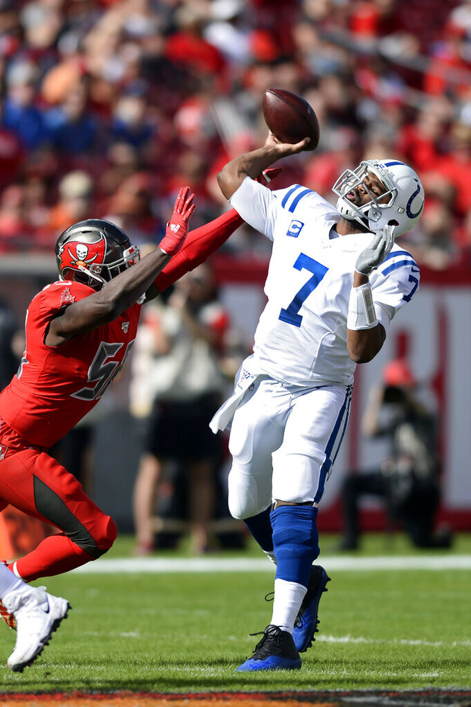 Indianapolis Colts quarterback Jacoby Brissett (7) throws a pass as he is pressured by Tampa Bay Buccaneers linebacker Shaquil Barrett (58) during the first half of an NFL football game Sunday, Dec. 8, 2019, in Tampa, Fla. (AP Photo/Jason Behnken)