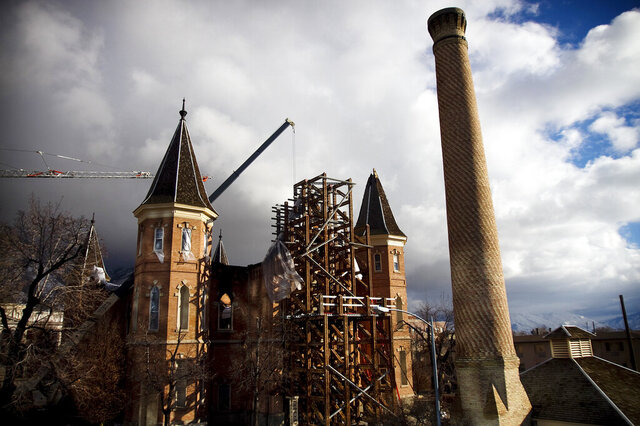 A construction crew works on removing debris from the burned Provo Tabernacle, Wednesday, Jan. 19, 2011, in Provo, Utah. For many, it seems unbelievable that 10 years have passed since the early morning hours of Dec. 17, 2010, when the historic Provo Tabernacle, decked out for Christmas, housed a raging fire that burned for hours. In what officials described at the time as likely a complete loss, the historic building was gutted by the blaze. (Mark Johnston/The Daily Herald via AP)