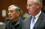 ADDS TO CLARIFY - IN ILLEGAL CAMPAIGN CONTRIBUTIONS TO COMMITTEES THAT SUPPORTED Real estate developer Samuel Leung, left, appears in court with his attorney Daniel V. Nixon as he faces charges of making nearly $200,000 in illegal campaign contributions to committees that supported Los Angeles Mayor Eric Garcetti and other Los Angeles politicians, in Los Angeles County Superior Court on Friday, Feb. 23, 2018. (AP Photo/Chris Pizzello)