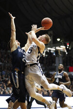 Butler guard Paul Jorgensen (5) shoots over Villanova guard Collin Gillespie (2) in the second half of an NCAA college basketball game in Indianapolis, Tuesday, Jan. 22, 2019. Villanova defeated Butler 80-72. (AP Photo/Michael Conroy)