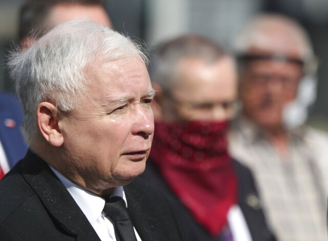 FILE - In this July 10, 2020 file photo, Poland's ruling party leader Jaroslaw Kaczynski, left, attends a police-guarded ceremony in Warsaw, Poland. An official with Poland's conservative governing party said Friday, Sept. 18, 2020, that the the country's right-wing coalition government has collapsed. (AP Photo/Czarek Sokolowski, file)