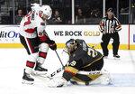Vegas Golden Knights goaltender Marc-Andre Fleury (29) defends against Ottawa Senators right wing Jordan Szwarz during the first period of an NHL hockey game Thursday, Oct. 17, 2019, in Las Vegas. (AP Photo/David Becker)