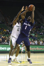 Jackson State guard Roland Griffin (1) attempts a shot over Baylor guard Jared Butler (12) in the first half of an NCAA college basketball game, Monday, Dec. 30, 2019, in Waco, Texas. (AP Photo/Jerry Larson)