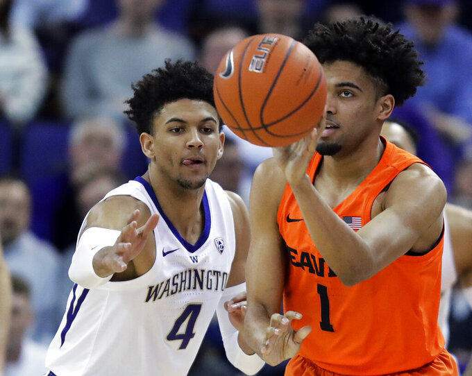 Oregon State guard Stephen Thompson Jr. (1) gets a pass off next to Washington guard Matisse Thybulle (4) during the first half of an NCAA college basketball game Wednesday, March 6, 2019, in Seattle. (AP Photo/Ted S. Warren)
