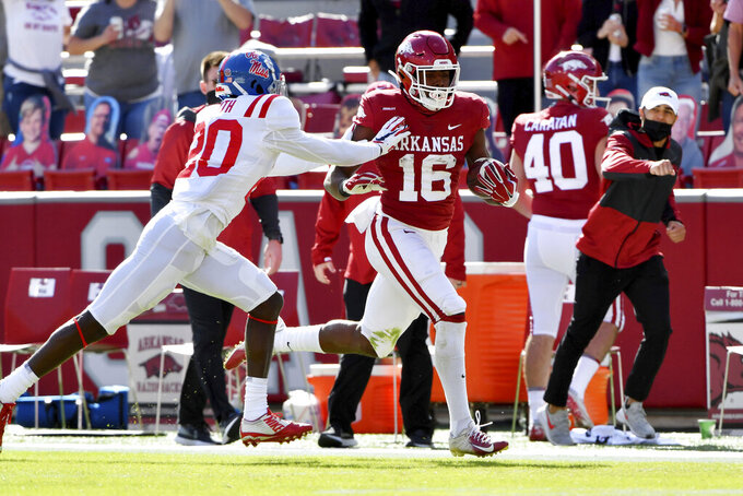 Arkansas receiver Treylon Burks (16) is pushed out of bounds by Mississippi defensive back Keidron Smith (20) after a big gain during the first half of an NCAA college football game Saturday, Oct. 17, 2020, in Fayetteville, Ark. (AP Photo/Michael Woods)