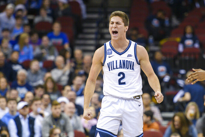 Villanova guard Collin Gillespie (2) celebrates during the first half of the Never Forget Tribute Classic NCAA college basketball game against Delaware, Saturday, Dec. 14, 2019, in Newark, N.J. (AP Photo/Corey Sipkin)