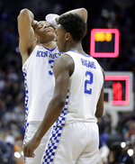 Kentucky's Keldon Johnson (3) and Ashton Hagans (2) react to losing the Midwest Regional final game against Auburn in the NCAA men's college basketball tournament Sunday, March 31, 2019, in Kansas City, Mo. Auburn won 77-71 in overtime. (AP Photo/Charlie Riedel)