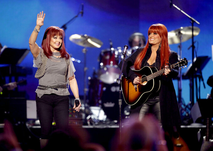 FILE - In this April 4, 2011 file photo, The Judds, Naomi Judd, left, and Wynonna Judd perform at the Girls' Night Out: Superstar Women of Country in Las Vegas. The Grammy-winning duo will be inducted into the Country Music Hall of Fame. (AP Photo/Julie Jacobson, File)