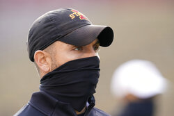 Iowa State head coach Matt Campbell stands on the field before an NCAA college football game against Kansas State, Saturday, Nov. 21, 2020, in Ames, Iowa. (AP Photo/Charlie Neibergall)