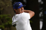 Brooks Koepka watches his tee shot on the 16th hole during the second round of the PGA Championship golf tournament at TPC Harding Park Friday, Aug. 7, 2020, in San Francisco. (AP Photo/Jeff Chiu)