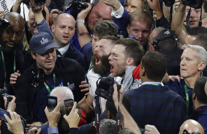 New England Patriots' Julian Edelman, left, and Tom Brady celebrate after the NFL Super Bowl 53 football game against the Los Angeles Rams, Sunday, Feb. 3, 2019, in Atlanta. The Patriots won 13-3. (AP Photo/Charlie Riedel)