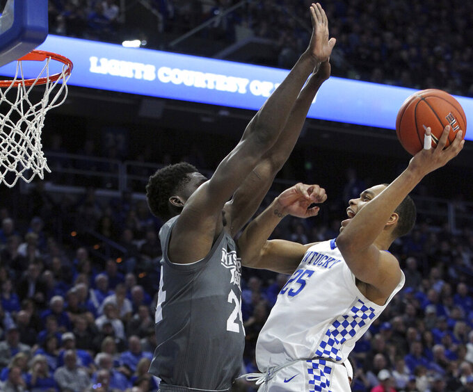 Kentucky's PJ Washington, right, shoots while defended by Mississippi State's Abdul Ado during the first half of an NCAA college basketball game in Lexington, Ky., Tuesday, Jan. 22, 2019. (AP Photo/James Crisp)