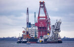 Tugboats get into position on the Russian pipe-laying vessel