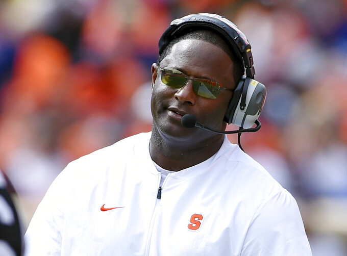 FILE - In this Saturday, Sept. 29, 2018, file photo, Syracuse head coach Dino Babers reacts to an officials call during the second half of an NCAA college football game against Clemson in Clemson, S.C. One thing is certain about Babers, he's getting a kick out of watching his special teams perform. (AP Photo/Richard Shiro, File)