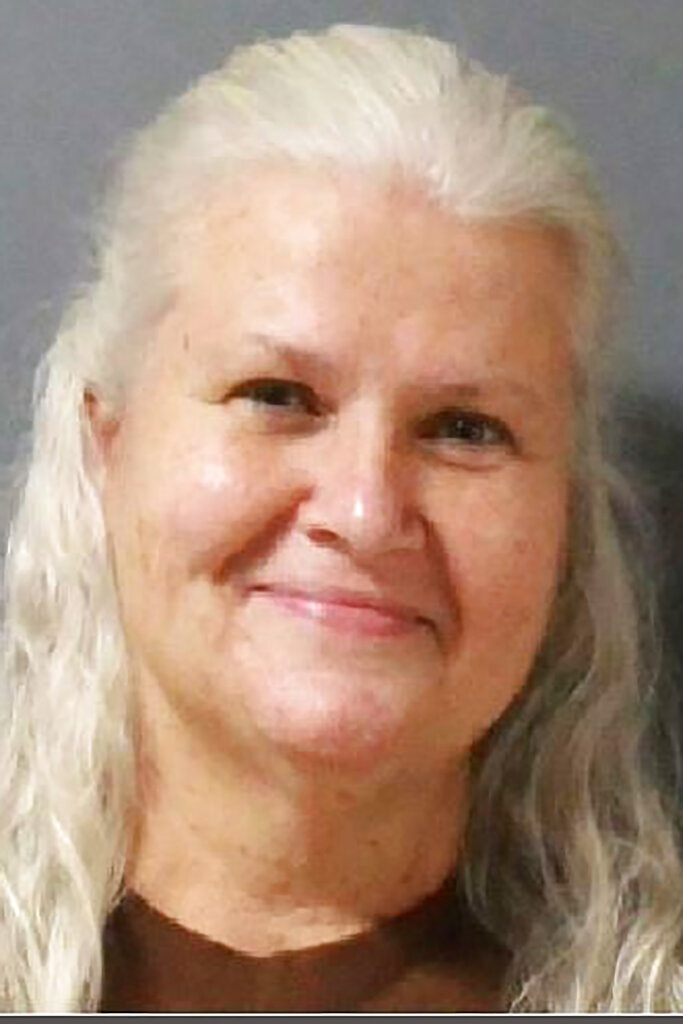 This undated photo provided by the Steele County, Minn., Jail shows Lois Riess. Riess a Minnesota woman who pleaded guilty to fatally shooting a woman in Florida so she could assume her identity has been returned to her home state to face trial on allegations that she killed her husband in 2018. Lois Riess is being held atthe Steele County Detention Center in Owatonna, Minn., on charges of first- and second-degree murder. She's accused of fatally shooting David Riess at their home in Blooming Prairie in March 2018. (Steele County Jail via AP)