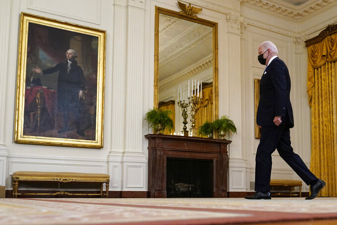 President Joe Biden arrives in the East Room of the White House to speak about vaccine requirements for federal workers in Washington, Thursday, July 29, 2021. (AP Photo/Susan Walsh)