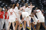 The Maryland basketball team celebrates after defeating Ohio State to win the NCAA college basketball championship game at the Big Ten Conference tournament, Sunday, March 8, 2020, in Indianapolis. Maryland defeated Ohio State 82-65. (AP Photo/Darron Cummings)