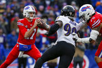 Buffalo Bills quarterback Josh Allen (17) looks to pass under pressure by Baltimore Ravens outside linebacker Matt Judon (99) during the second half of an NFL football game against the Baltimore Ravens in Orchard Park, N.Y., Sunday, Dec. 8, 2019. (AP Photo/John Munson)