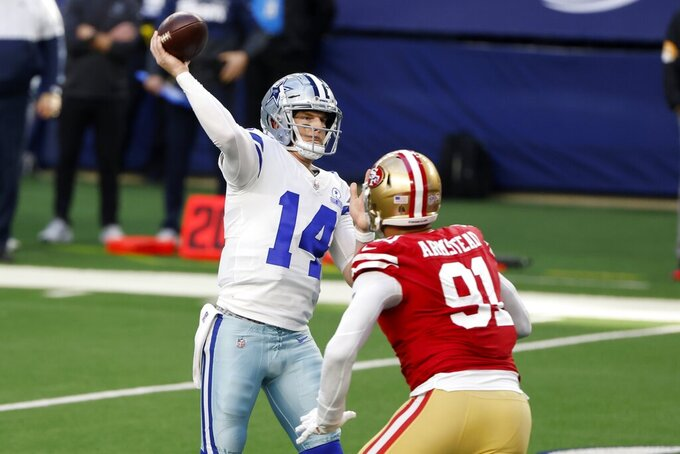 Dallas Cowboys quarterback Andy Dalton (14) throws a touchdown pass to Michael Gallup under pressure from San Francisco 49ers defensive end Arik Armstead (91) in the first half of an NFL football game in Arlington, Texas, Sunday, Dec. 20, 2020. (AP Photo/Michael Ainsworth)