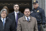 Joseph Percoco, second from right, a former top aide to New York Gov. Andrew Cuomo, leaves U.S. District court, Tuesday, March 13, 2018, in New York. Percoco was convicted on corruption charges Tuesday at a trial that further exposed the state capital's culture of backroom deal-making. (AP Photo/Mary Altaffer)