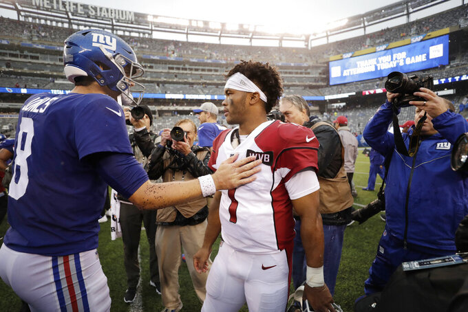 Arizona Cardinals quarterback Kyler Murray, center, greets New York Giants quarterback Daniel Jones, left, after an NFL football game, Sunday, Oct. 20, 2019, in East Rutherford, N.J. (AP Photo/Adam Hunger)