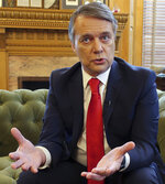 FILE - In this file photo taken Dec. 20, 2018, departing Kansas Gov. Jeff Colyer responds to questions from The Associated Press during an interview in his office in the Statehouse in Topeka, Kan.  Former Republican Gov. Jeff Colyer is calling for a GOP primary challenger for freshman Rep. Steve Watkins in his eastern Kansas district. Colyer on Tuesday, August 27, 2019 urged state Treasurer Jake LaTurner to drop out of next year's U.S. Senate race in Kansas and run for Watkins' congressional seat.  (AP Photo/John Hanna, File)