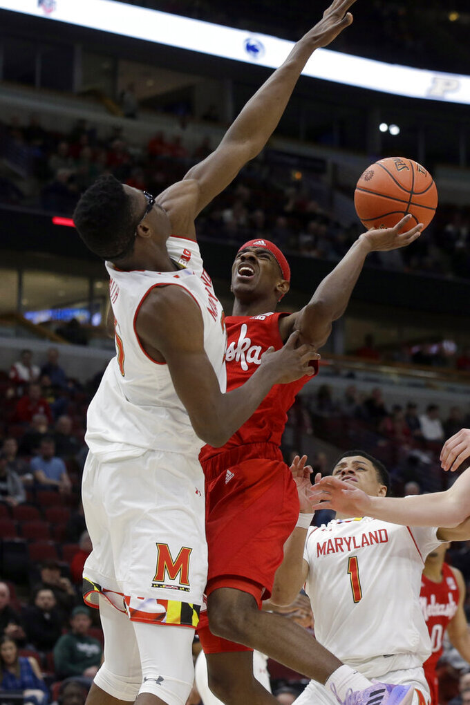 Nebraska's Glynn Watson Jr. goes up for a shot against Maryland's Jalen Smith, right, during the second half of an NCAA college basketball game in the second round of the Big Ten Conference tournament, Thursday, March 14, 2019, in Chicago. (AP Photo/Kiichiro Sato)