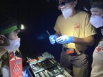Myotis Bat caught by Utah Division of Natural Resources are surveyed Wednesday, May 26, 2021.  Utah biologists are working to protect bats from a fungus called White Nose Syndrome. It attacks the skin of the bats while they hibernate and wakes them.   (Elle Cabrera /The Spectrum via AP)